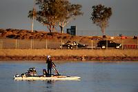 Nov. 22, 2008; Chandler, AZ, USA; IHBA top alcohol hydro driver Terry Blattler climbs from his boat after his qualifying run during the Napa Auto Parts World Finals at Firebird Lake. Mandatory Credit: Mark J. Rebilas-