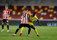 1st October 2020; Brentford Community Stadium, London, England; English Football League Cup, Carabao Cup Football, Brentford FC versus Fulham; Emiliano Marcondes of Brentford grapples with Neeskens Kebano of Fulham for the ball