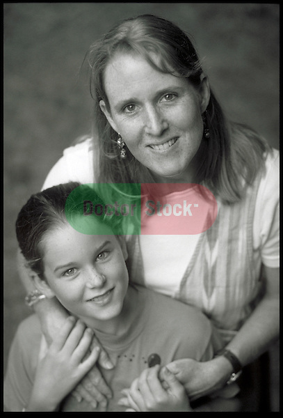 portrait of smiling mother embracing girl