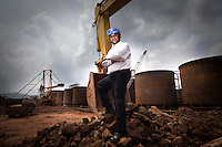 Chief Operating Officer of Vedanta Aluminum Ltd, Dr. Mukesh Kumar, poses for a portrait on raw unprocessed bauxite at the Vedanta plant in Lanjigarh. The huge bauxite deposits in the Niyamgiri hills have led the Vedanta group to set up an alumina refinery at Lanjigarh, making the local population of Dongria Kondh tribespeople fearful for their future. Vedanta Resources has come under immense pressure from human rights and environmental groups to abandon its plans to mine at the Niyamgiri mountains, as the site is considered sacred by the local tribal community..