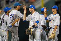 UCLA second baseman Cody Regis (18) celebrates with his teammates follow their win against the North Carolina State Wolfpack in Game 8 of the 2013 Men's College World Series on June 18, 2013 at TD Ameritrade Park in Omaha, Nebraska. The Bruins defeated the Wolfpack 2-1, eliminating North Carolina State from the tournament. (Andrew Woolley/Four Seam Images)