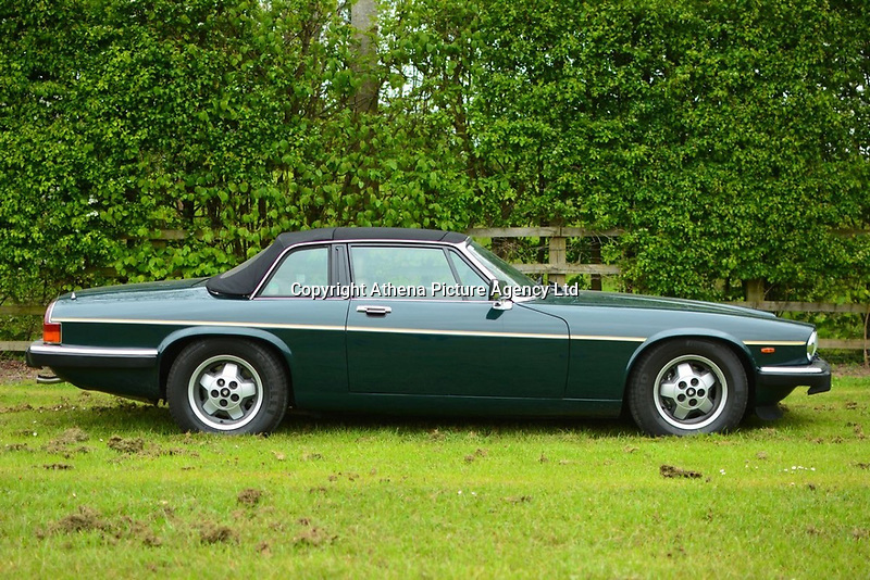 """Pictured: The Jaguar up for auction, once owned by Eamonn Holmes<br /> Re: A luxury open-top car sold by TV's Eamonn Holmes to pay off his """"massive"""" tax bill is up for grabs at auction.<br /> The host of Good Morning Britain bought the 5.3 litre Jaguar when he was earning big bucks with the BBC.<br /> But Eamonn was made redundant and at the same time he was hit with an £11,000 demand from the Inland Revenue.<br /> The car was costing him a fortune to run - it did under 15mpg.<br /> After paying a whopping £36,000 for the Jaguar XJSC, Eamonn flogged it for just £8,000 a year later.<br /> The car has an identical price tag at auction almost 30 years later.    <br /> Eamonn, 57, told how he got shot of the Jag when the 1990 Gulf War sparked a big hike in fuel prices.<br /> He said: """"Cars are my weakness - in 1989 I bought a British Racing Green Jaguar.<br /> """"I paid £36,000 in March 1989 then in early 1990 the Gulf War broke out."""