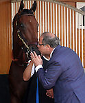 April 29, 2015 American Pharoah gets a kiss from his owner, Ahmed Zayat of Zayat Stables, during schooling in the Churchill Downs paddock.  ©Mary M. Meek/ESW/CSM