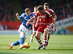 Aberdeen v St Johnstone...03.10.15   SPFL   Pittodrie, Aberdeen<br /> Steven MacLean takes on Andy Considine<br /> Picture by Graeme Hart.<br /> Copyright Perthshire Picture Agency<br /> Tel: 01738 623350  Mobile: 07990 594431