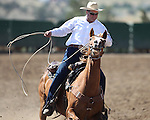 Nick Uhart competes in the team roping event at the Minden Ranch Rodeo on Sunday, July 24, 2011, in Gardnerville, Nev. .Photo by Cathleen Allison