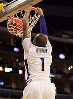 """5'11"""" Venoy Overton dunks the ball on the breakaway. The Washington Huskies defeated the Oregon State Beavers 59-52 during the Pac-10 Tournament at the Staples Center in Los Angeles, California on March 11th, 2010."""