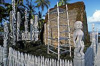 Hale o Keawe, a reconstructed temple, wooden figures, and lele (offering platform) at Puuhonua O Honaunau National Historical Park (City of Refuge)