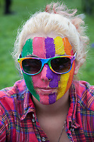 Portrait of girl wearing rainbow colored face paint and glasses, Seattle PrideFest 2015, Pride Festival, Washington, USA.
