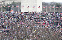 Supporters in front of the Washington Monument as US President Donald J. Trump delivers remarks to supporters gathered to protest Congress' upcoming certification of Joe Biden as the next president on the Ellipse in Washington, DC, USA, 06 January 2021. Various groups of Trump supporters are gathering to protest as Congress prepares to meet and certify the results of the 2020 US Presidential election.<br /> Credit: Shawn Thew / Pool via CNP/AdMedia