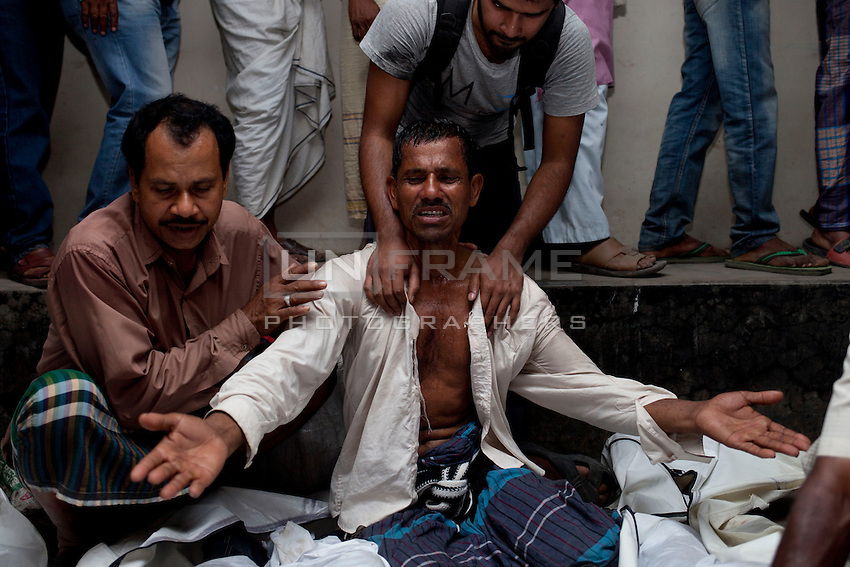 Bangladeshi relatives mourn the bodies of victims after a river ferry carrying more than 100 passengers capsized in the River Padma on Sunday after being hit by a cargo vessel at Paturia, in Manikganj district, about 80 kilometers  northwest of Dhaka, Bangladesh. Feb. 22, 2015