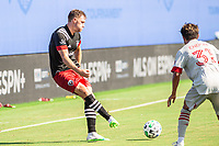 LAKE BUENA VISTA, FL - JULY 13: Julian Gressel #31 of DC United passes the ball during a game between D.C. United and Toronto FC at Wide World of Sports on July 13, 2020 in Lake Buena Vista, Florida.