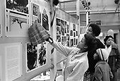 North Paddington residents look at an exhibition of photographs produced by North Paddington Community Darkroom for the Mayday 1978 opening of the Factory arts centre (now the Yaa Asantewa Centre).