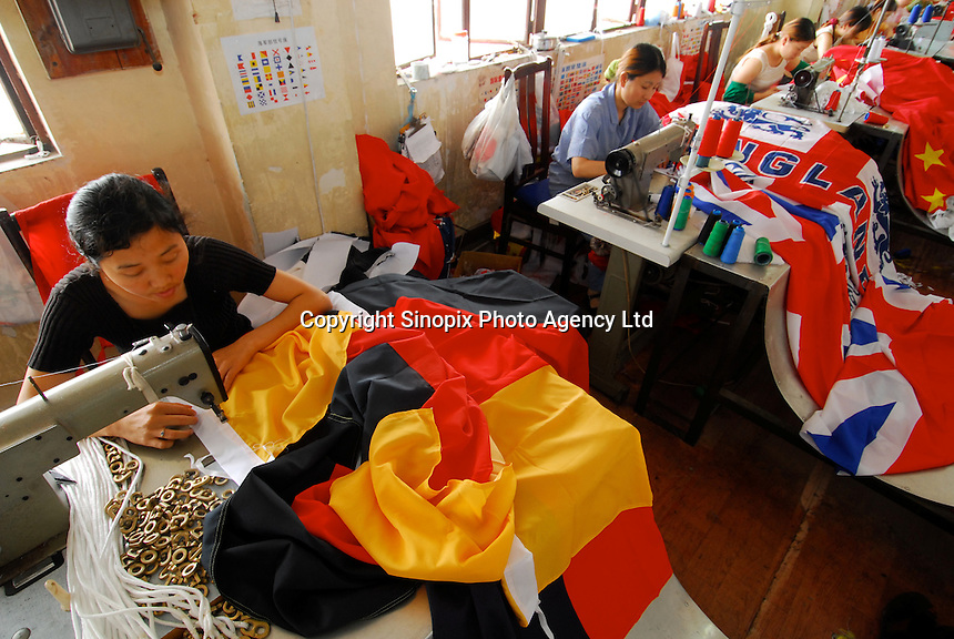 The German National flag is made at the Shanghai Flag and Tent Co. Ltd., on the out-skirts of Shanghai. .