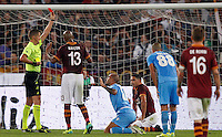 Calcio, Serie A: Roma vs Napoli. Roma, stadio Olimpico, 18 ottobre 2013.<br /> Referee Daniele Orsato, left, gives a red card to Napoli defender Paolo Cannavaro, third from left, during the Italian Serie A football match between AS Roma and Napoli at Rome's Olympic stadium, 18 October 2013.<br /> UPDATE IMAGES PRESS/Riccardo De Luca