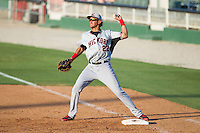 Hickory Crawdads first baseman Ronald Guzman (22) makes a throw to second base against the Kannapolis Intimidators at CMC-Northeast Stadium on May 4, 2014 in Kannapolis, North Carolina.  The Intimidators defeated the Crawdads 3-1.  (Brian Westerholt/Four Seam Images)