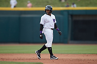 Yoelqui Cespedes (15) of the Winston-Salem Dash takes his lead off of second base during the game against the Greensboro Grasshoppers at Truist Stadium on June 19, 2021 in Winston-Salem, North Carolina. (Brian Westerholt/Four Seam Images)