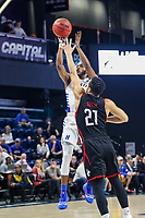 Washington, DC - March 10, 2020: Hofstra Pride guard Desure Buie (4) shoots the ball during the CAA championship game between Hofstra and Northeastern at  Entertainment and Sports Arena in Washington, DC.   (Photo by Elliott Brown/Media Images International)