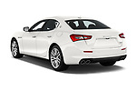 Car pictures of rear three quarter view of a 2020 Maserati Ghibil Base 4 Door Sedan angular rear