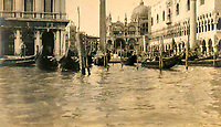 BNPS.co.uk (01202 558833)<br /> Pic: Lawrences/BNPS<br /> <br /> Grand Canal in Venice<br /> <br /> It's Top-hat Gear...<br /> <br /> Photos documenting three middle-aged men's European road trip that resembles an Edwardian version of Top Gear has come to light 109 years later.<br /> <br /> The trio of upper class Brits spent two months driving from Britain to Venice in Italy in a luxury motor car in 1910.<br /> <br /> They stopped off at glamorous spots along the way including Nice, Monte Carlo and Lake Como.