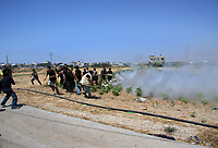 """Hamas demonstration in the Karni crossing east of Gaza City that injured 10 people and killing people by the Israeli army on May 22, 2008 """"photo by Thair alhassany"""""""