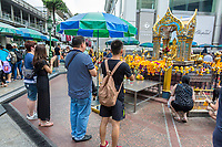Bangkok, Thailand.  Worshipers Arriving at the Erawan Shrine.