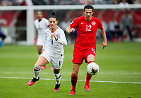 CARSON, CA - FEBRUARY 9: Christine Sinclair #12 of Canada moves with the ball past Ali Krieger #11 during a game between Canada and USWNT at Dignity Health Sports Park on February 9, 2020 in Carson, California.