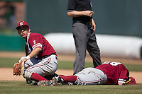 LOS ANGELES, CA - April 10, 2011: Lonnie Kauppila of Stanford baseball looks at the runner at third after colliding with pitcher Danny Sandbrink in pursuit of a grounder during Stanford's game against USC at Dedeaux Field in Los Angeles. Stanford lost 6-2.