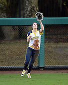 Michigan Wolverines outfielder Nicole Sappingfield (15) catches a fly ball during the season opener against the Florida Gators on February 8, 2014 at the USF Softball Stadium in Tampa, Florida.  Florida defeated Michigan 9-4 in extra innings.  (Copyright Mike Janes Photography)