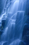 The overcast sky in early morning casts a blue light on Proxy Falls, Oregon.