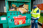 Donal O'Mahoney shifting through the cardboard at the Milltown Recycling and Waste Disposal Centre