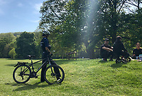 HIGH WYCOMBE, ENGLAND - 23.04.2020 - <br /> A Police officer asks a group to move on as they sit eating food, the response is that they are exercising in a park during the COVID-19 pandemic lockdown as the UK Government advice to maintain social distancing and minimise time outside in High Wycombe on 23 April 2020. Photo by PRiME Media Images / Andy Rowland.
