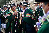 Men play music and drink in Soracachi, near Oruro during the Carnaval de Oruro. During the fiesta many people sacrifice llamas and give offerings such as coca leaves and cigarettes to show their dedication to the Devil, a Virgin, Pachamama or Mother Earth. The Devil (or Uncle) is a mythical character that protects the miners of Oruro who work in dangerous conditions hundreds of metres below the ground. During the carnival, people dress in outrageous costumes and dance for days before arriving at the Church of Socavon, where they pay their respects to a virgin. Ironically, many of the dancers wear devil costumes.