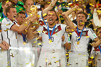 Lukas Podolski of Germany celebrates winning the FIFA World Cup trophy with team mates