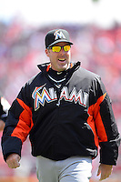 Miami Marlins manager Mike Redmond #11 walks off the field during a game against the Cincinnati Reds at Great American Ball Park on April 20, 2013 in Cincinnati, Ohio.  Cincinnati defeated Miami 3-2 in 13 innings.  (Mike Janes/Four Seam Images)