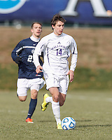 Williams midfielder Chris Seitz (14) brings the ball forward.  NCAA Division III Sectionals. Williams College (white) defeated Brandeis University (blue/white), 2-0, on Hitchcock Field at Amherst College on November 23, 2013.