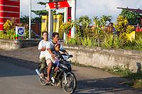 Bali, Indonesia.  Family on Motorbike, no Helmets.