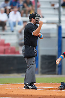 Home plate umpire Nick Susie makes a strike call during the Appalachian League game between the Elizabethton Twins and the Kingsport Mets at Hunter Wright Stadium on July 8, 2015 in Kingsport, Tennessee.  The Mets defeated the Twins 8-2. (Brian Westerholt/Four Seam Images)