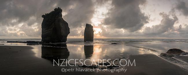 Remains of Three Sisters at sunset on coastline near New Plymouth, Taranaki Region, North Island, New Zealand, NZ