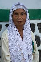 Borobudur, Java, Indonesia.  Old Javanese Woman and Headscarf.