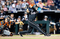 Mississippi State Bulldogs outfielder Jake Mangum (15) follows through on his swing during Game 4 of the NCAA College World Series against the Auburn Tigers on June 16, 2019 at TD Ameritrade Park in Omaha, Nebraska. Mississippi State defeated Auburn 5-4. (Andrew Woolley/Four Seam Images)