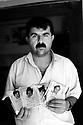 Iraq 2007.A man of Halabja showing photos of members of his family killed by chemical bombs.<br /> Irak 2007.Un habitant d'Halabja montrant des photos de membres de sa famille tues par les bombardements chimiques
