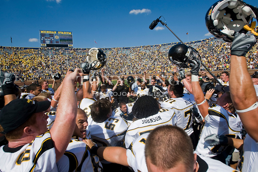 1 September 2007: Appalachian State players and coaches celebrate at center field within Michigan Stadium after upsetting the no. 5 ranked Michigan Wolverines 34-32, in a 2007 college football season opener game, in Ann Arbor, MI.