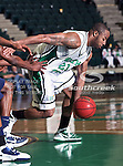 North Texas Mean Green guard Shannon Shorter (21) in action during the NCAA  basketball game between the South Alabama Jaguars and the University of North Texas Mean Green at the North Texas Coliseum,the Super Pit, in Denton, Texas. UNT defeated South Alabama 82 to 79...