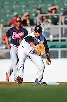 Lansing Lugnuts first baseman Rowdy Tellez (44) stretches for a throw during a game against the Peoria Chiefs on June 6, 2015 at Cooley Law School Stadium in Lansing, Michigan.  Lansing defeated Peoria 6-2.  (Mike Janes/Four Seam Images)