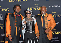 "LOS ANGELES, USA. July 10, 2019: Atandwa Kani, Mandi Kani & John Kani at the world premiere of Disney's ""The Lion King"" at the Dolby Theatre.<br /> Picture: Paul Smith/Featureflash"