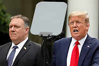 United States President Donald J. Trump with members of his administration delivers remarks on China in the Rose Garden at the White House in Washington, DC on May 29, 2020.  At left is US Secretary of State Mike Pompeo.<br /> Credit: Yuri Gripas / Pool via CNP/AdMedia