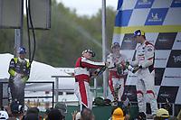 #9: Pfaff Motorsports Porsche 911 GT3R, GTD: Zacharie Robichon, Laurens Vanthoor, #1: Paul Miller Racing Lamborghini Huracan GT3, GTD: Madison Snow, Bryan Sellers, #14: Vasser Sullivan Lexus RC F GT3, GTD: Jack Hawksworth , Aaron Telitz celebrate on the podium with champagne