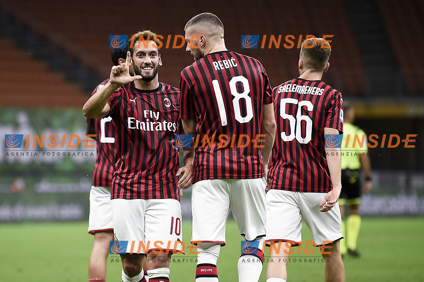 Hakan Calhanoglu of AC Milan celebrates with Ante Rebic of AC Milan after scoring a goal during the Serie A football match between AC Milan and Bologna FC at stadio Giuseppe Meazza in Milano ( Italy ), July 18th, 2020. Play resumes behind closed doors following the outbreak of the coronavirus disease. <br /> Photo Image Sport / Insidefoto