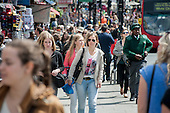 Young people in Camden High Street, Camden, London.