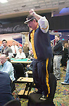 Humberto Brenes celebrates on a chair after winning a hand against Phil Hellmuth.